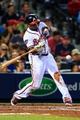 Apr 11, 2014; Atlanta, GA, USA; Atlanta Braves left fielder Justin Upton (8) hits a home run in the eighth inning against the Washington Nationals at Turner Field. Mandatory Credit: Daniel Shirey-USA TODAY Sports
