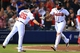 Apr 11, 2014; Atlanta, GA, USA; Atlanta Braves left fielder Justin Upton (8) celebrates a home run with second baseman Dan Uggla (26) in the eighth inning against the Washington Nationals at Turner Field. Mandatory Credit: Daniel Shirey-USA TODAY Sports