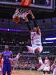 Apr 11, 2014; Chicago, IL, USA; Chicago Bulls forward Taj Gibson (22) dunks past Detroit Pistons guard Kentavious Caldwell-Pope (5) during the second half at the United Center. Chicago won 106-98. Mandatory Credit: Dennis Wierzbicki-USA TODAY Sports