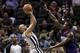 Apr 11, 2014; San Antonio, TX, USA; San Antonio Spurs guard Patrick Mills (8) shoots the ball over Phoenix Suns guard Eric Bledsoe (right) during the second half at AT&T Center. The Spurs won 112-104. Mandatory Credit: Soobum Im-USA TODAY Sports
