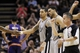 Apr 11, 2014; San Antonio, TX, USA; San Antonio Spurs guard Danny Green (4) celebrates a score with teammates during the second half against the Phoenix Suns at AT&T Center. The Spurs won 112-104. Mandatory Credit: Soobum Im-USA TODAY Sports