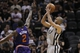 Apr 11, 2014; San Antonio, TX, USA; San Antonio Spurs guard Tony Parker (9) shoots the ball over Phoenix Suns guard Eric Bledsoe (2) during the second half at AT&T Center. The Spurs won 112-104. Mandatory Credit: Soobum Im-USA TODAY Sports