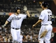 Apr 11, 2014; San Diego, CA, USA; San Diego Padres third baseman Chase Headley (7) celebrates with left fielder Seth Smith (12) after hitting a two-run home run during the sixth inning against the Detroit Tigers at Petco Park. Mandatory Credit: Christopher Hanewinckel-USA TODAY Sports