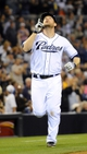 Apr 11, 2014; San Diego, CA, USA; San Diego Padres third baseman Chase Headley (7) reacts after hitting a two-run home run during the sixth inning against the Detroit Tigers at Petco Park. Mandatory Credit: Christopher Hanewinckel-USA TODAY Sports