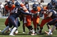 Apr 12, 2014; Charlottesville, VA, USA; Virginia Cavaliers running back Kye Morgan (36) carries the ball as Cavaliers linebacker Henry Coley (44) attempts the tackle during the Cavaliers Spring Game at Scott Stadium. Mandatory Credit: Geoff Burke-USA TODAY Sports