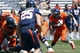 Apr 12, 2014; Charlottesville, VA, USA; Virginia Cavaliers running back Taquan Mizzell (4) carries the ball as  Virginia Cavaliers safety David Marrs (25) chases during the Cavaliers Spring Game at Scott Stadium. Mandatory Credit: Geoff Burke-USA TODAY Sports