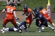 Apr 12, 2014; Charlottesville, VA, USA; Virginia Cavaliers running back LaChaston Smith (30) carries the ball past Cavaliers cornerback Maurice Canady (26) and linebacker Henry Coley (44) during the Cavaliers Spring Game at Scott Stadium. Mandatory Credit: Geoff Burke-USA TODAY Sports