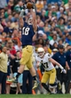 Apr 12, 2014; Notre Dame, IN, USA; Notre Dame Fighting Irish tight end Ben Koyack (18) catches the ball in front of cornerback Connor Cavalaris (47) in the first quarter of the Blue-Gold game at Notre Dame Stadium. Mandatory Credit: Matt Cashore-USA TODAY Sports