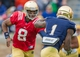 Apr 12, 2014; Notre Dame, IN, USA; Notre Dame Fighting Irish quarterback Malik Zaire (8) hands the ball off to running back Greg Bryant (1) in the third quarter of the Blue-Gold game at Notre Dame Stadium. Mandatory Credit: Matt Cashore-USA TODAY Sports