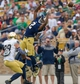 Apr 12, 2014; Notre Dame, IN, USA; Notre Dame Fighting Irish cornerback Josh Atkinson (24) and safety Nicky Baratti (29) break up a pass intended for wide receiver Chris Brown (2) in the third quarter of the Blue-Gold game at Notre Dame Stadium. Mandatory Credit: Matt Cashore-USA TODAY Sports