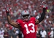 Apr 12, 2014; Columbus, OH, USA; Ohio State scarlet team cornerback Eli Apple (13) celebrates his squad's first-quarter touchdown during the Ohio State Buckeyes spring game at Ohio Stadium. The scarlet team won the game 17-7. Mandatory Credit: Greg Bartram-USA TODAY Sports