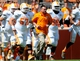 Apr 12, 2014; Knoxville, TN, USA; Tennessee Volunteers head coach Butch Jones runs onto the field during the orange and white spring game at Neyland Stadium. Mandatory Credit: Randy Sartin-USA TODAY Sports