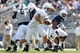 Apr 12, 2014; State College, PA, USA; Penn State Nittany Lions quarterback Austin Whipple (16) drops back to hand off the ball in the fourth quarter of the Blue White spring game at Beaver Stadium. The Blue team defeated the White team 37-0. Mandatory Credit: Matthew O'Haren-USA TODAY Sports