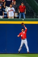 Apr 12, 2014; Atlanta, GA, USA; Washington Nationals left fielder Bryce Harper (34) jumps to make a catch in the second inning against the Atlanta Braves at Turner Field. Mandatory Credit: Daniel Shirey-USA TODAY Sports