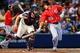 Apr 12, 2014; Atlanta, GA, USA; Washington Nationals shortstop Ian Desmond (20) avoids the tag by Atlanta Braves catcher Evan Gattis (24) after striking out in the third inning at Turner Field. Mandatory Credit: Daniel Shirey-USA TODAY Sports