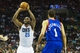 Apr 12, 2014; Charlotte, NC, USA; Charlotte Bobcats center Al Jefferson (25) shoots the ball during the second half against the Philadelphia 76ers at Time Warner Cable Arena. The Bobcats defeated the 76ers 111-105. Mandatory Credit: Jeremy Brevard-USA TODAY Sports