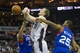 Apr 12, 2014; Charlotte, NC, USA; Charlotte Bobcats center Cody Zeller (40) gets fouled by Philadelphia 76ers forward Brandon Davies (20) during the second half at Time Warner Cable Arena. The Bobcats defeated the 76ers 111-105. Mandatory Credit: Jeremy Brevard-USA TODAY Sports