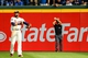 Apr 12, 2014; Atlanta, GA, USA; Umpire Angel Hernandez (55) confirms that the ball is stuck under the wall on a ground rule double by Washington Nationals shortstop Ian Desmond (20) in the eighth inning against the Atlanta Braves at Turner Field. Mandatory Credit: Daniel Shirey-USA TODAY Sports