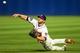 Apr 12, 2014; Atlanta, GA, USA; Atlanta Braves second baseman Dan Uggla (26) fields Washington Nationals second baseman Danny Espinosa (8) single in the ninth inning at Turner Field. The Braves won 6-3. Mandatory Credit: Daniel Shirey-USA TODAY Sports