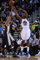 Apr 6, 2014; Oakland, CA, USA; Golden State Warriors guard Jordan Crawford (55) passes the basketball against Utah Jazz guard Ian Clark (21) and forward Jeremy Evans (40) during the fourth quarter at Oracle Arena. The Warriors defeated the Jazz 130-102. Mandatory Credit: Kyle Terada-USA TODAY Sports