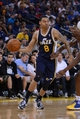 Apr 6, 2014; Oakland, CA, USA; Utah Jazz guard Diante Garrett (8) dribbles the basketball against the Golden State Warriors during the fourth quarter at Oracle Arena. The Warriors defeated the Jazz 130-102. Mandatory Credit: Kyle Terada-USA TODAY Sports