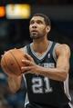 Apr 8, 2014; Minneapolis, MN, USA; San Antonio Spurs forward Tim Duncan (21) shoots at Target Center. Mandatory Credit: Brad Rempel-USA TODAY Sports