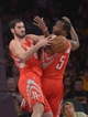 Apr 8, 2014; Los Angeles, CA, USA; Houston Rockets forwards Omri Casspi (18) and Jordan Hamilton (5) battle for the ball during the game against the Los Angeles Lakers at Staples Center. Mandatory Credit: Kirby Lee-USA TODAY Sports