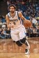 Apr 8, 2014; Minneapolis, MN, USA; Minnesota Timberwolves guard Ricky Rubio (9) dribbles at Target Center. Mandatory Credit: Brad Rempel-USA TODAY Sports