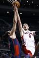Apr 13, 2014; Auburn Hills, MI, USA; Toronto Raptors guard Nando de Colo (3) shoots on Detroit Pistons forward Luigi Datome (13) in the second quarter at The Palace of Auburn Hills. Mandatory Credit: Rick Osentoski-USA TODAY Sports