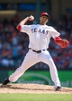 Apr 13, 2014; Arlington, TX, USA; Texas Rangers starting pitcher Alexi Ogando (41) pitches during the ninth inning against the Houston Astros at Globe Life Park in Arlington. Ogando gets his first save of the year. The Rangers shut out the Astros 1-0. Mandatory Credit: Jerome Miron-USA TODAY Sports