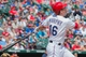 Apr 13, 2014; Arlington, TX, USA; Texas Rangers third baseman Donnie Murphy (16) drives in a run during the sixth inning against the Houston Astros at Globe Life Park in Arlington. Mandatory Credit: Jerome Miron-USA TODAY Sports