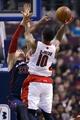 Apr 13, 2014; Auburn Hills, MI, USA; Toronto Raptors guar atDeMar DeRozan (10) shoots on Detroit Pistons forward Jonas Jerebko (33) in the fourth quarter at The Palace of Auburn Hills. Toronto won 116-107. Mandatory Credit: Rick Osentoski-USA TODAY Sports