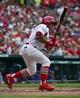 Apr 13, 2014; St. Louis, MO, USA; St. Louis Cardinals second baseman Kolten Wong (16) hits a single RBI against the Chicago Cubs at Busch Stadium. Mandatory Credit: Scott Rovak-USA TODAY Sports