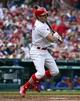 Apr 13, 2014; St. Louis, MO, USA; St. Louis Cardinals center fielder Peter Bourjos (8) hits a triple against the Chicago Cubs at Busch Stadium. The Cardinals won 6-4. Mandatory Credit: Scott Rovak-USA TODAY Sports