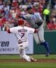 Apr 13, 2014; St. Louis, MO, USA;Chicago Cubs shortstop Starlin Castro (13) turns a double play over St. Louis Cardinals left fielder Matt Holliday (7) at Busch Stadium. The Cardinals won 6-4. Mandatory Credit: Scott Rovak-USA TODAY Sports