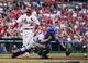 Apr 13, 2014; St. Louis, MO, USA; Chicago Cubs catcher Welington Castillo (5) reaches for the wide throw as St. Louis Cardinals right fielder Allen Craig (21) scores a run at Busch Stadium. The Cardinals defeated the Cubs 6-4. Mandatory Credit: Scott Rovak-USA TODAY Sports