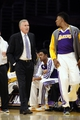 Apr 13, 2014; Los Angeles, CA, USA;  Los Angeles Lakers head coach Mike D'Antoni talks to forward Nick Young (0) before sending him into the game against the Memphis Grizzlies at Staples Center. Mandatory Credit: Robert Hanashiro-USA TODAY Sports