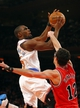 Apr 13, 2014; New York, NY, USA;  Chicago Bulls guard Kirk Hinrich (12) fouls New York Knicks guard Tim Hardaway Jr. (5) as he drives to the basket during the second half at Madison Square Garden. New York Knicks defeat the Chicago Bulls 100-89. Mandatory Credit: Jim O'Connor-USA TODAY Sports
