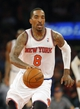 Apr 13, 2014; New York, NY, USA;  New York Knicks guard J.R. Smith (8) brings the ball up court during the second half against the Chicago Bulls at Madison Square Garden. New York Knicks defeat the Chicago Bulls 100-89. Mandatory Credit: Jim O'Connor-USA TODAY Sports