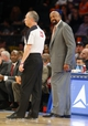 Apr 13, 2014; New York, NY, USA;  New York Knicks head coach Mike Woodson questions referee Jason Phillips (23) during the second half at Madison Square Garden. New York Knicks defeat the Chicago Bulls 100-89. Mandatory Credit: Jim O'Connor-USA TODAY Sports