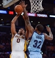 Apr 13, 2014; Los Angeles, CA, USA;  Memphis Grizzlies forward Ed Davis (32) blocks a shot by Los Angeles Lakers forward Nick Young (0) during second quarter action at Staples Center. Mandatory Credit: Robert Hanashiro-USA TODAY Sports