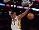 Apr 13, 2014; Los Angeles, CA, USA;  Los Angeles Lakers forward Wesley Johnson (11) dunks on a break away during the second quarter action the Memphis Grizzlies at Staples Center. Mandatory Credit: Robert Hanashiro-USA TODAY Sports