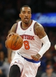 Apr 13, 2014; New York, NY, USA;  New York Knicks guard J.R. Smith (8) brings the ball up the court during the second half against the Chicago Bulls at Madison Square Garden. New York Knicks defeat the Chicago Bulls 100-89. Mandatory Credit: Jim O'Connor-USA TODAY Sports