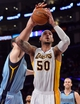 Apr 13, 2014; Los Angeles, CA, USA; Memphis Grizzlies center Kosta Koufos (41) blocks a shot attempts by Los Angeles Lakers center Robert Sacre (50) during fourth quarter action at Staples Center. Mandatory Credit: Robert Hanashiro-USA TODAY Sports