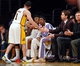 Apr 13, 2014; Los Angeles, CA, USA;  Los Angeles Lakers guard Jordan Farmar (1) slaps hands with injured teammate Pau Gasol as he heads to the bench near the end of the Lakers 102-90 at Staples Center. Mandatory Credit: Robert Hanashiro-USA TODAY Sports