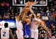 Apr 2, 2014; Phoenix, AZ, USA; Los Angeles Clippers forward Blake Griffin (32) shoots the ball under pressure from Phoenix Suns forward Channing Frye (8) and center Miles Plumlee (22) during the third quarter at US Airways Center. The Clippers won 112-108. Mandatory Credit: Casey Sapio-USA TODAY Sports
