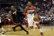 Apr 14, 2014; Washington, DC, USA; Washington Wizards guard Bradley Beal (3) dribbles the ball past Miami Heat guard Mario Chalmers (15) in the first quarter at Verizon Center. Mandatory Credit: Geoff Burke-USA TODAY Sports
