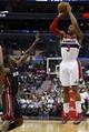 Apr 14, 2014; Washington, DC, USA; Washington Wizards guard Bradley Beal (3) shoots the ball over Miami Heat guard Toney Douglas (0) in the first quarter at Verizon Center. Mandatory Credit: Geoff Burke-USA TODAY Sports