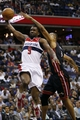 Apr 14, 2014; Washington, DC, USA; Washington Wizards forward Martell Webster (9) attempts to dunk the ball while being fouled by Miami Heat forward Rashard Lewis (9) in the second quarter at Verizon Center. Mandatory Credit: Geoff Burke-USA TODAY Sports