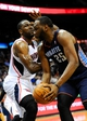 Apr 14, 2014; Atlanta, GA, USA; Charlotte Bobcats center Al Jefferson (25) tries to get past forward Elton Brand (42) during the first half at Philips Arena. Mandatory Credit: Dale Zanine-USA TODAY Sports